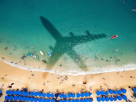 plane shadow over beach