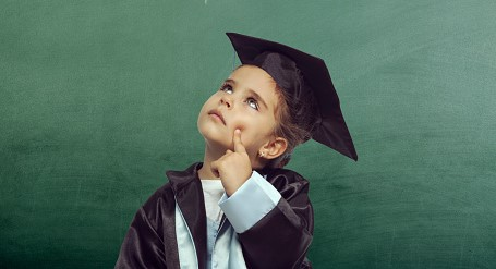 Young child in Cap and Gown