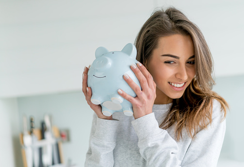 Girl checking piggy bank
