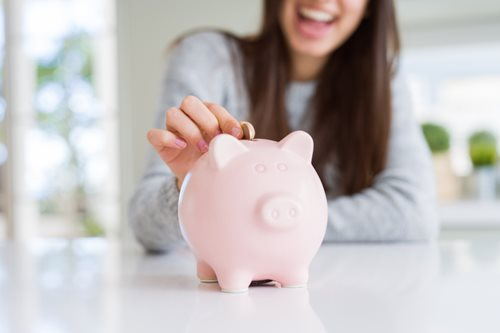 a girl and a piggy bank